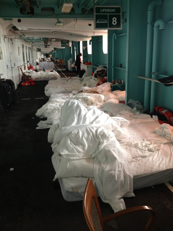 Carnival Cruise Lines president urges Triumph passengers to stop being so negative about their unforgettable cruise experience Carnival Triumph Beds Hallway