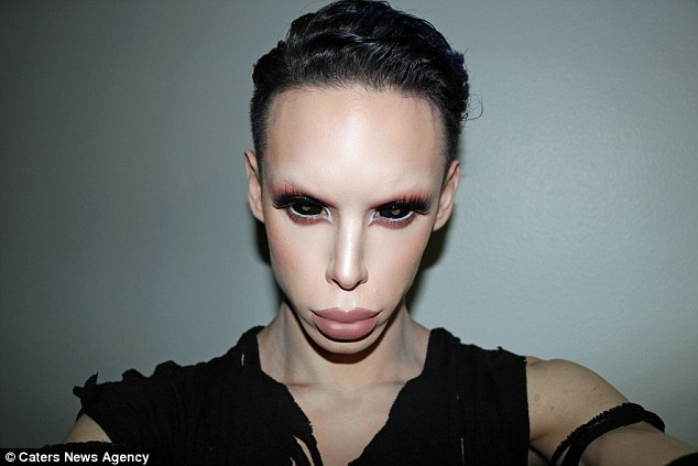 "Image: Man spends $50,000 on over 100 procedures to transform into a ""genderless"" ALIEN"
