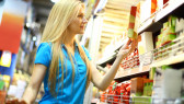 Woman-In-Supermarket-Buying-Food-Label-I