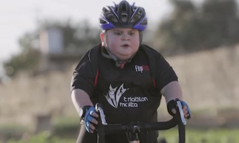 Image: Rare disease forces 7 year old to compete in triathlons