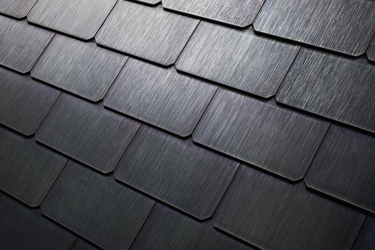 "Image: Coming to a Home Depot near you: Tesla's ""invisible"" solar roof tiles and home energy storage units will become available this year"
