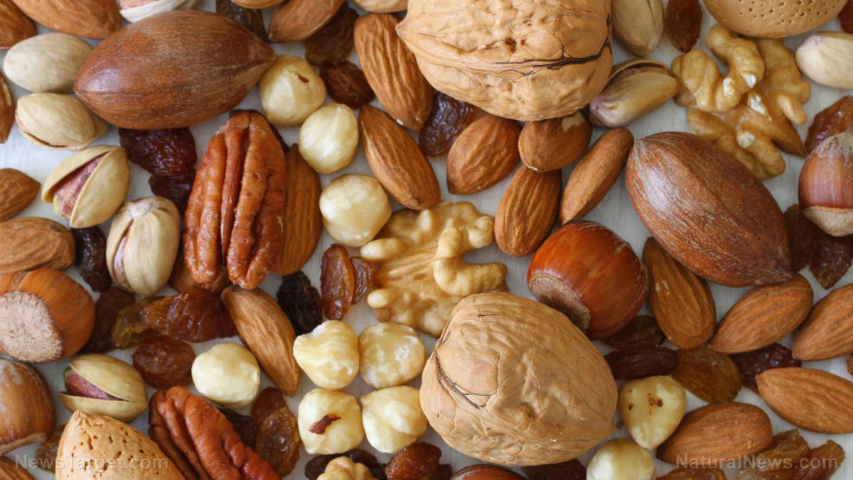 Image: Eating nuts and seeds found to cut your risk of premature death by HALF