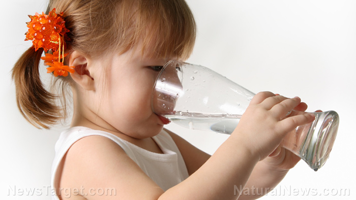Image: Dehydrated children: Kids are drinking about one quarter of the water they should be, according to new study