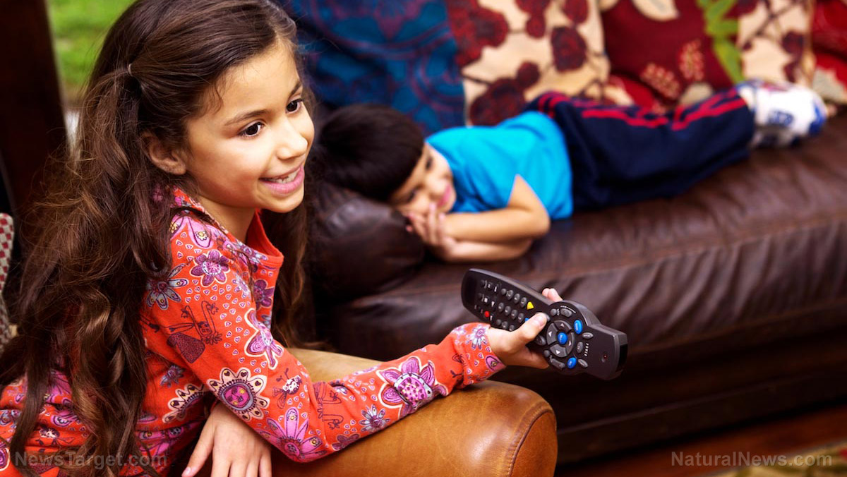 Image: Experts warn that kids who watch TV see more ads for junk food, consuming on average 500 more snacks per year than kids who don't