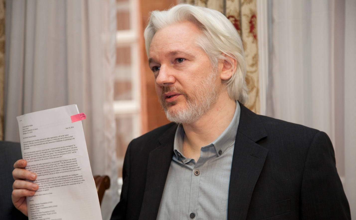 Image: How is what Julian Assange has done with Wikileaks any different than U.S. newspaper coverage of Watergate or the Pentagon Papers?