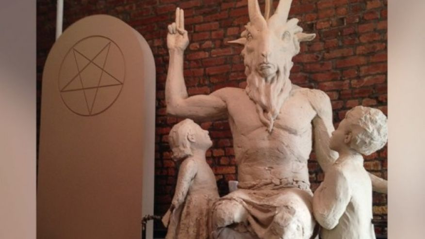 Image: BIZARRE: Avon catalog features image of woman caressing baphomet