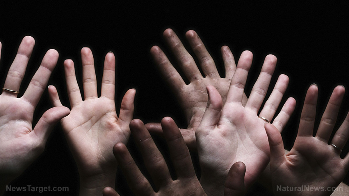 Image: Surrender? North Carolina cops kneel before protesters