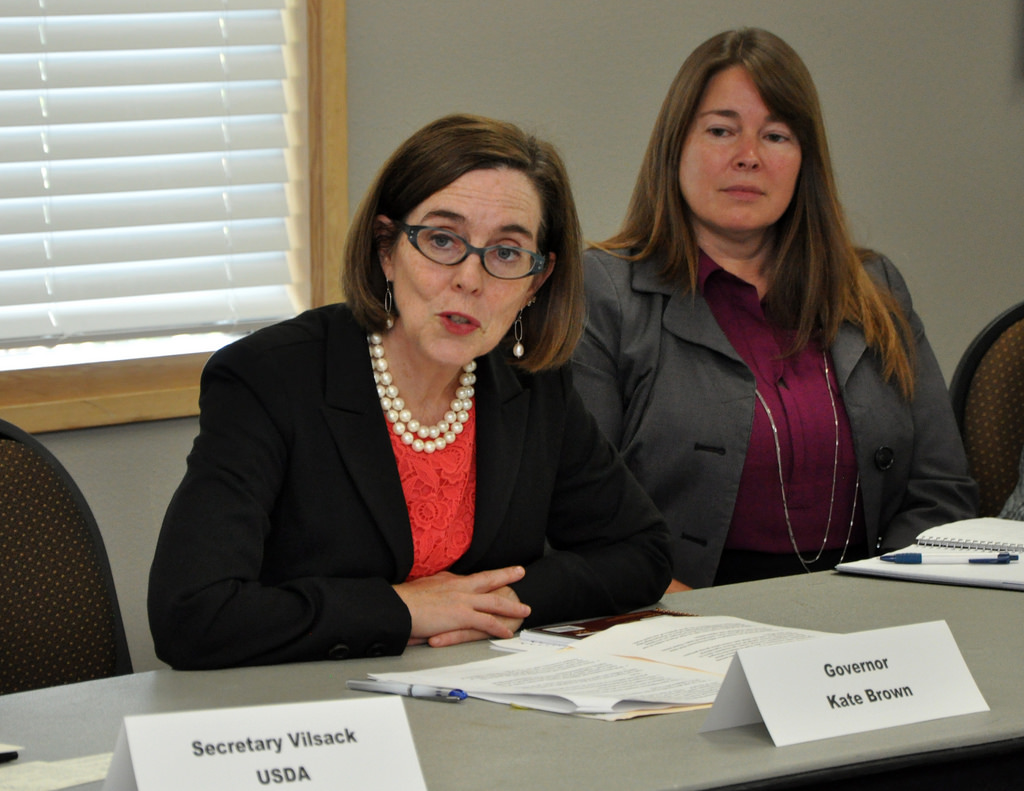 Image: Oregon's Gov. Kate Brown said people should call the police on neighbors who violate coronavirus restrictions on Thanksgiving