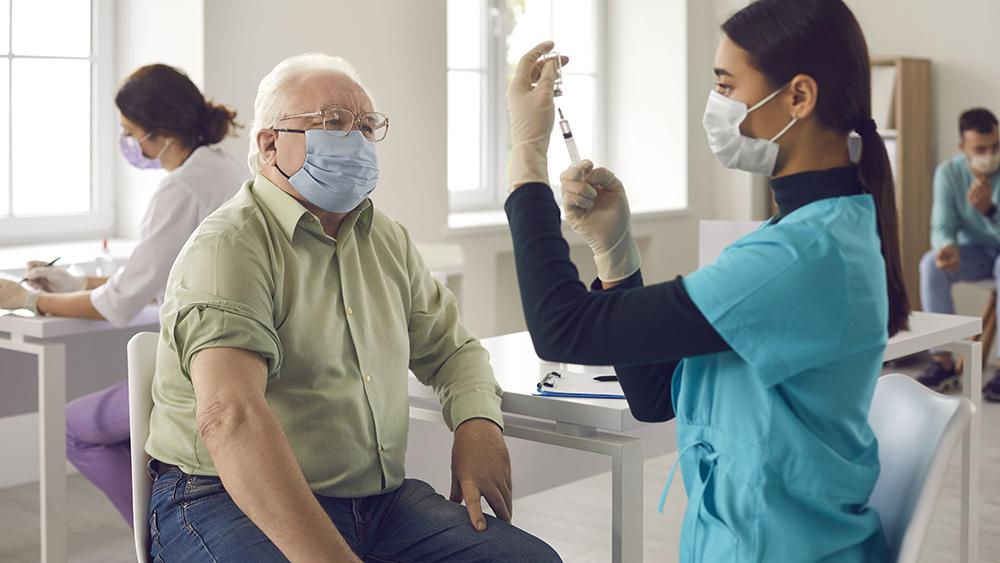 Covid-19-Coronavirus-Senior-Man-Nurse-Mask-Vaccine-Syringe.jpg